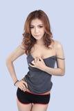 Beautiful female model wearing gray tank top Stock Images