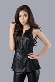 Beautiful female model wearing a leather dress royalty free stock images