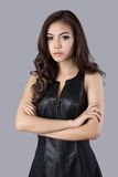 Beautiful female model wearing a leather dress. In studio Stock Images