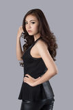 Beautiful female model wearing a leather dress. In studio Royalty Free Stock Images