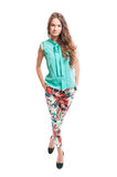 Beautiful female model wearing tide and colored pants Stock Photos
