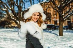 Beautiful female model in winter hat, portrait. stock photography