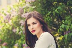 Beautiful female model woman in flowers garden Stock Photography