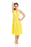 Beautiful female model in yellow dress. Stock Photo