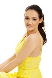 Beautiful female model in yellow dress. Royalty Free Stock Images