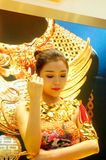 Beautiful female models show gold jewelry at the Shenzhen International Jewelry Show Stock Photography