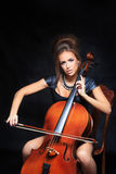 Beautiful female musician playing a cello. Royalty Free Stock Image
