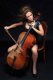 Beautiful female musician playing a cello. Royalty Free Stock Photos
