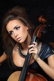Beautiful female musician playing a cello. Royalty Free Stock Photography