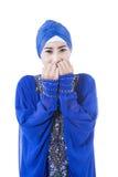Beautiful female muslim bite hands on white Royalty Free Stock Image