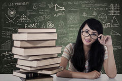 Beautiful female nerd student study in class Royalty Free Stock Photography