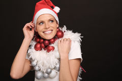Beautiful female nikolaus. Beautiful young female nikolaus with some christmas balls royalty free stock photos