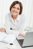 Beautiful female office worker Stock Image