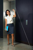 Beautiful Female Office Worker Celebrating Stock Photography