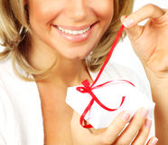 Beautiful female opening gift Stock Photography