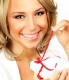 Beautiful female opening gift Stock Photo