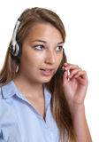Beautiful female operator talking at phone Royalty Free Stock Photography