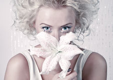 Beautiful female with original make up and flower Stock Photo