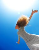 Beautiful female over blue clean sky Stock Photography