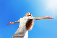 Beautiful female over blue clean sky Stock Image