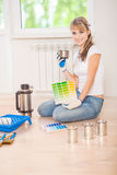 Beautiful female painter drinking coffee in new house Royalty Free Stock Images