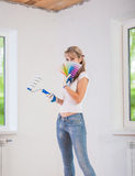 Beautiful female painter hide her face Royalty Free Stock Photos