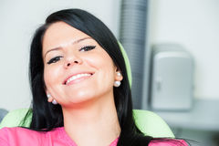 Beautiful female patient smiling after bleaching or whitening. In dental office royalty free stock photos