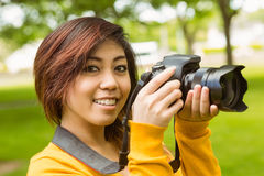 Beautiful female photographer at park Stock Photo