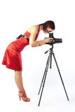 Beautiful female photographer in red dress Stock Image