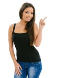 Beautiful female pointing and smiling Royalty Free Stock Image