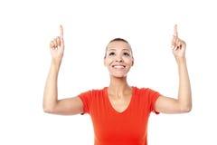 Beautiful female pointing upwards Royalty Free Stock Image