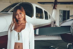 Beautiful female portrait in the airplane hangar, with modern ai Stock Image