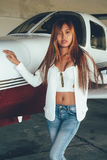 Beautiful female portrait in the airplane hangar, with modern ai Royalty Free Stock Photos