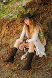 Beautiful female portrait dressed in dreamcatcher bracelets and black leather hat, indie style stock photography