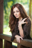 Beautiful female portrait with long brown hair outdoor.   Royalty Free Stock Photography