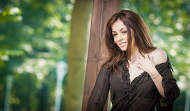 Beautiful female portrait with long brown hair outdoor.    Stock Photos