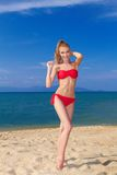 Beautiful female posing in red bikini Royalty Free Stock Image