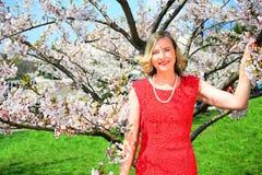Beautiful female posing in the sakura garden Stock Photo