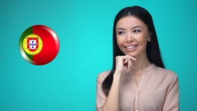 Beautiful female pushing Portuguese flag button, ready to learn foreign language. Stock footage stock footage