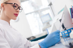 Beautiful female researcher is working with papers Royalty Free Stock Photography