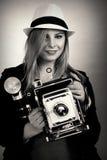 Beautiful female retro photographer Stock Photography