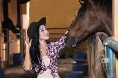 Beautiful female rider and horse at ranch royalty free stock photo