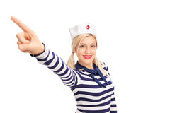 Beautiful female sailor pointing up with her finger Royalty Free Stock Photos