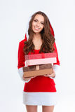 Beautiful female in santa claus costume standing with two gifts Stock Photography