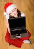 Beautiful female santa with laptop Royalty Free Stock Photos
