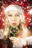 Beautiful Female Santa Making Christmas Wish Stock Photos