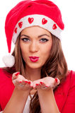 Beautiful female Santa sending kisses Stock Images
