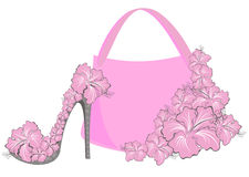 Beautiful female shoes and bags. With hibiscus Stock Photo