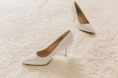 Beautiful female shoes on a white background. With diferent angle royalty free stock photo