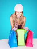 Beautiful female shopper checking her purchases Royalty Free Stock Photos
